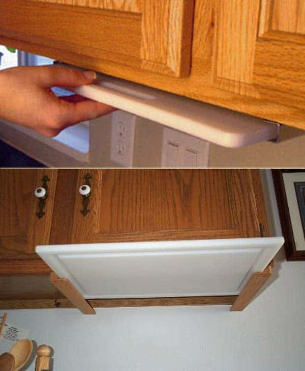 chopping board under the kitchen cabinet