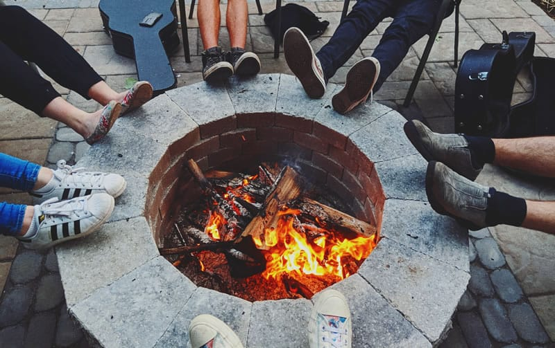 people sitting around a firepit